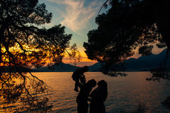 Silhouette of a family with children against the backdrop of the setting sun and sea. In Montenegro Royalty Free Stock Images
