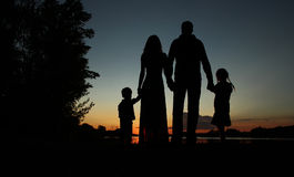 Silhouette of a family with children Stock Photo