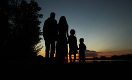 Silhouette of a family with children Stock Image