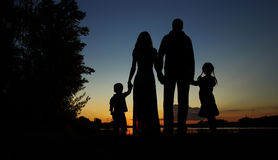 Silhouette of a family with children Royalty Free Stock Photography