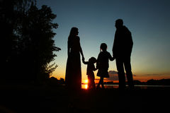 Silhouette of a family with children Stock Images