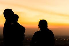 Silhouette of family at dusk. Silhouette of family at dusk royalty free stock photo