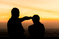 Silhouette of family at dusk. Silhouette of family at dusk royalty free stock images