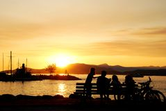 Silhouette of a family enjoy beautiful sunset view Stock Photos