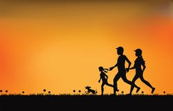 Silhouette of family exercising and jogging together at the park Royalty Free Stock Photos