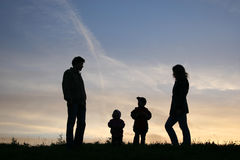 Silhouette family of four Stock Image