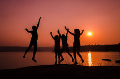 Silhouette family jumping Royalty Free Stock Photo