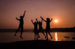 Silhouette family jumping Royalty Free Stock Image
