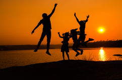 Silhouette family jumping Royalty Free Stock Images