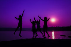 Silhouette family jumping Stock Photo