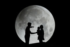 Silhouette of family with moon Royalty Free Stock Image