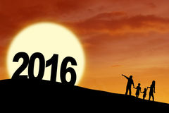Silhouette family with numbers 2016 at hill Royalty Free Stock Photos