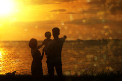 Silhouette of family in outdoor sunset stock images