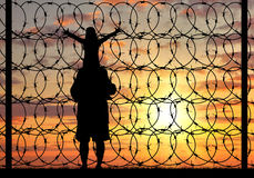 Silhouette of a family refugee Stock Image