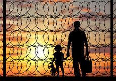 Silhouette of a family refugee Stock Photography