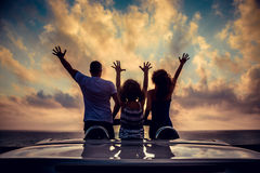 Silhouette of family relaxing on the beach Stock Photo