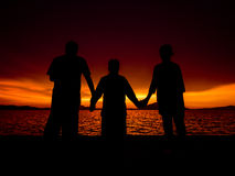 Silhouette of family at sunrise. Silhouette of happy family at sunrise Royalty Free Stock Photos