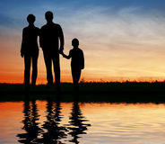 Silhouette family on sunset Royalty Free Stock Photography