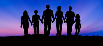 Silhouette of Family at Sunset Stock Photo