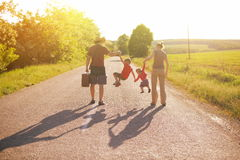 Silhouette of family walking in park on sunrise Royalty Free Stock Photography