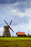 Silhouette of a farm , house and windmill. Landscape Stock Image