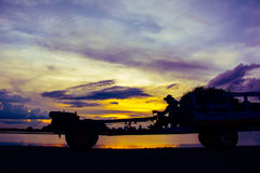 Silhouette of farm tractor on sunset.  Royalty Free Stock Photography