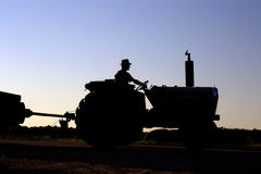Silhouette of farmer on tractor Royalty Free Stock Images