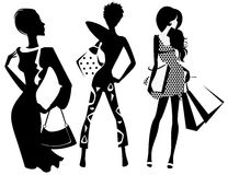 Silhouette of fashion girl with bags Stock Image