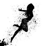Silhouette of the fashionable woman with paint splashes. Royalty Free Stock Photos