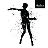 Silhouette of the fashionable woman with paint splashes. Stock Photography
