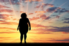 Silhouette fat woman sunset Royalty Free Stock Photography