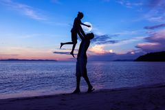 Free Silhouette Father And Daughter On The Beach With The Moon And Bl Stock Photo - 101739420