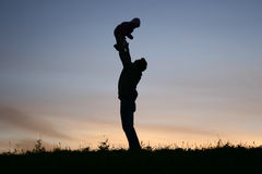 Silhouette father with baby Royalty Free Stock Image
