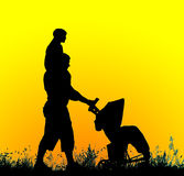 Silhouette of a father with a baby stroller carrying a child on Stock Image