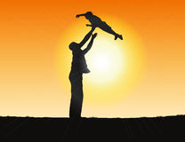 Silhouette of a father and child Stock Image