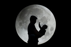 Silhouette of father and child with moon Stock Images