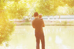 Silhouette of father and child. Outdoors Royalty Free Stock Photo
