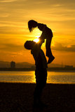 Silhouette of Father and daughter Stock Image