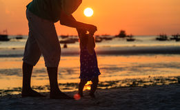 Silhouette of father and daughter on the beach Royalty Free Stock Photo