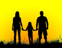 Silhouette father, mother and daughter holding hands at sunset Royalty Free Stock Photo