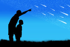 Silhouette of father point his son look at star Stock Photo