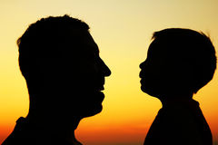 Silhouette of father and son play Stock Images