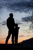 Silhouette of father and son in sunset sky Stock Photo