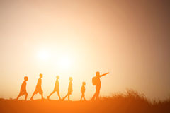 Silhouette father walking with children go to travel royalty free stock photos