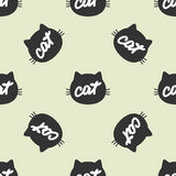 Silhouette of feline head with handwritten text Cat. Color seamless pattern. Stock Photos