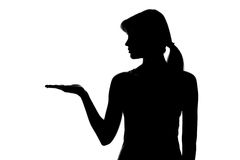 Silhouette of a female figure on a white background Stock Photos