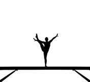 Silhouette of female gymnast on balance beam Royalty Free Stock Photo