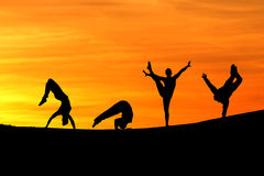 Silhouette of female gymnasts Stock Photos