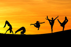 Silhouette of female gymnasts Royalty Free Stock Photography