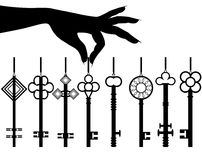 Silhouette female hand hold key set Royalty Free Stock Photos